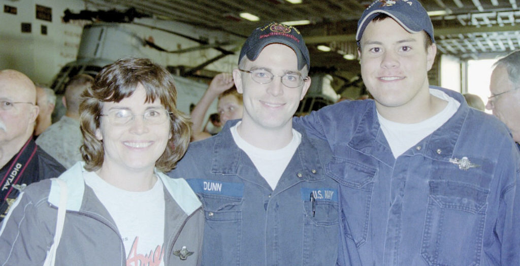 Above: Lori Criswell and sons Bradley (center) and Will aboard USS Tarawa; below,Will in pre-flight.