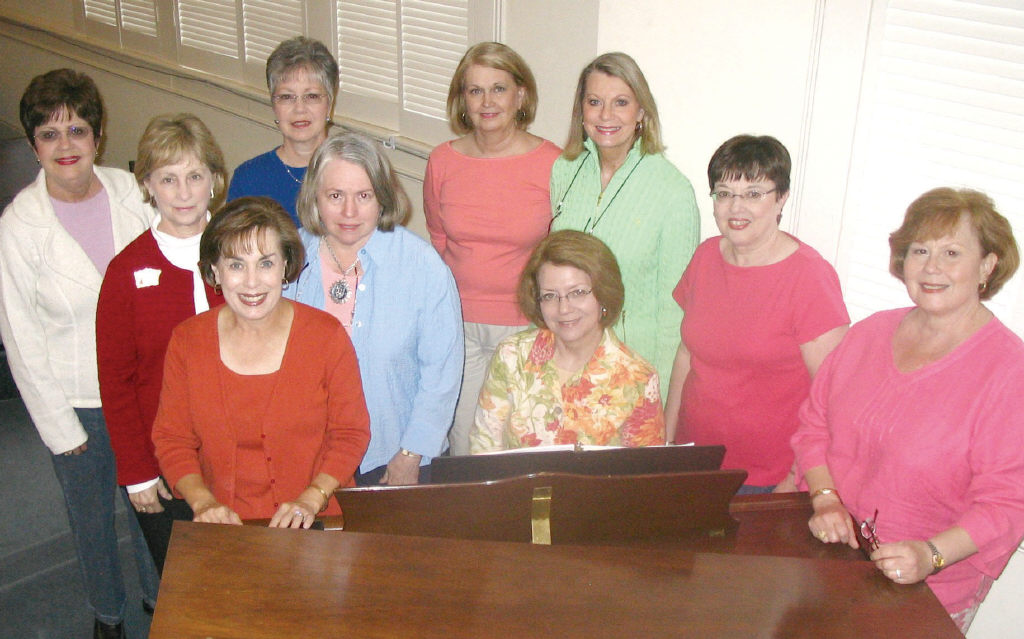 Ten of the women preparing for the first Oneonta Girls' Chorus concert gather before one of their Monday night practices at Lester Memorial United Methodist Church. Pictured are Emily Tish, seated, and (standing, from left) Jo Ann Shea, Carol Hanson, Celia Ellis, Becky Meigs, Joan Ledford, Martha Butler, Jan Bess, Beverly Ellis and Frances Barnett.