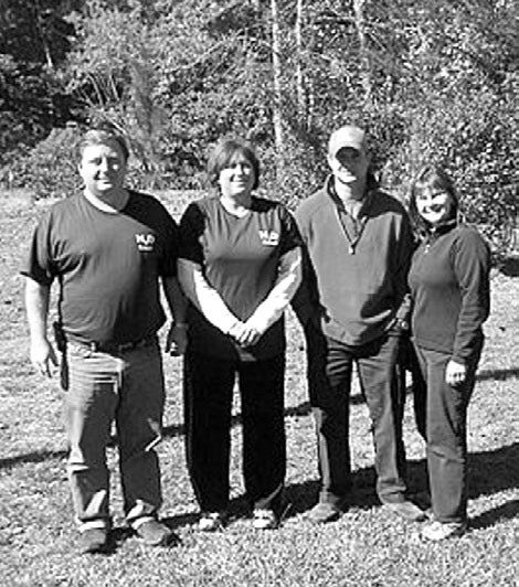Pictured at the 1100-acre outdoor classroom at McDowell Environmental Center near Jasper where they attended a three-day course are (from left) Darren White, science teacher from Hayden Middle School; Deb Hicks, teacher of the gifted at Oneonta Elementary; Brandon Maniscalco, science teacher, Hayden Middle; and Debra Gordon- Hellman, Friends of the Locust Fork River's education committee.