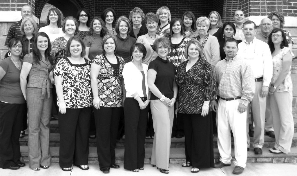 Above: The staff of Oneonta's HomeTown Bank: (front row, left to right) Christina Cervantes, Judy Wilemon, Cassi Cline, Jill Jackson, Jeanie Walker, Suzanne Robertson, Tanya Turner, and Chris Duvall. Middle row: Sherrie Hicks, Randa Dennis, Jessica Waldrop, Sheena Adams, Patti Young, Hope Glover, Becky Heptinstall, Giselle Zavala, Danny Kelly, Hal Buckelew, and Melissa Lewis. Back row: Sam Pate, Angela Blakely, Diana Barrientos, Carla Cornelius, Brenda Best, Mitsy Stewart, Cristy Cunningham, Amy Holmes, Todd Washburn, and Joann Miller. Not pictured: Bruce Latta, Christina Killough, Gary Smith, Denny Kelly, and Kayley Whited.
