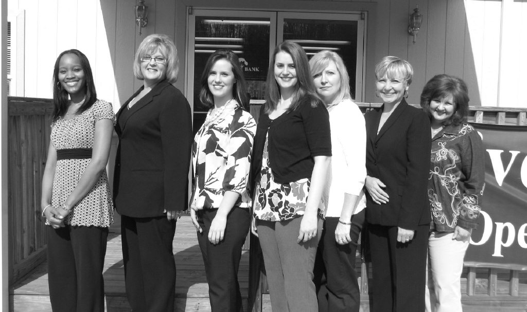Below: Welcoming you to HomeTown Bank Pinson are (left to right) Shauna Beavers, Carla Hill, Joanna Fore, Stefanie Burgess, Karen Bice, Debby Arington, and Dina Fowler. Alys Stephens is not pictured.