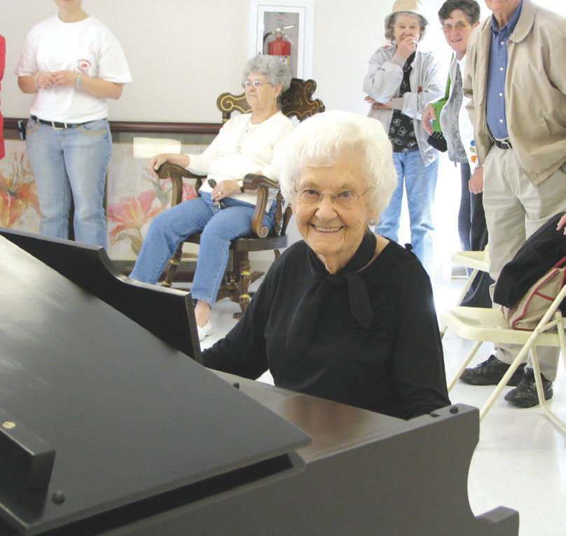 Velvie Lyles finds the new piano to be to her liking at the Snead senior citizens center.