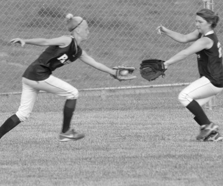 Tiffany Watson (left) catches a flyball with Kana Sherbet backing her up.