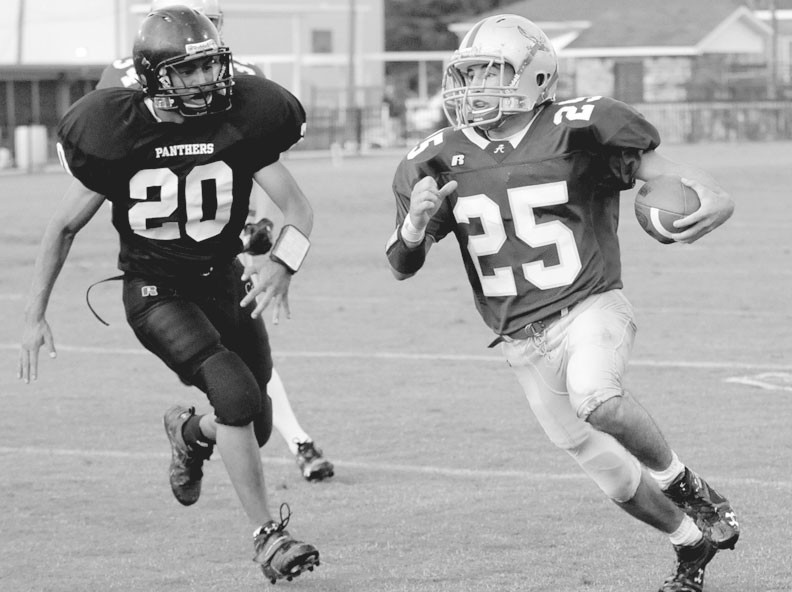 Appalachian's Jake Cornelius looks for room as Cleveland's Fabian Cervantes closes in.
