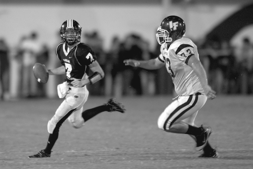 –courtesy www.southernexposurephotos.com Panther quarterback Dusty Cornelius tries to escape the pressure of Locust Fork's D.J. Lackey.