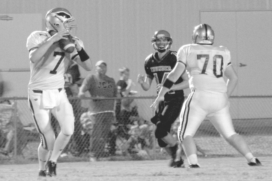 –photo courtesy Kelly Cornelius Appalachian quarterback Cameron Cox looks downfield behind the blocking of Lamar Nix.