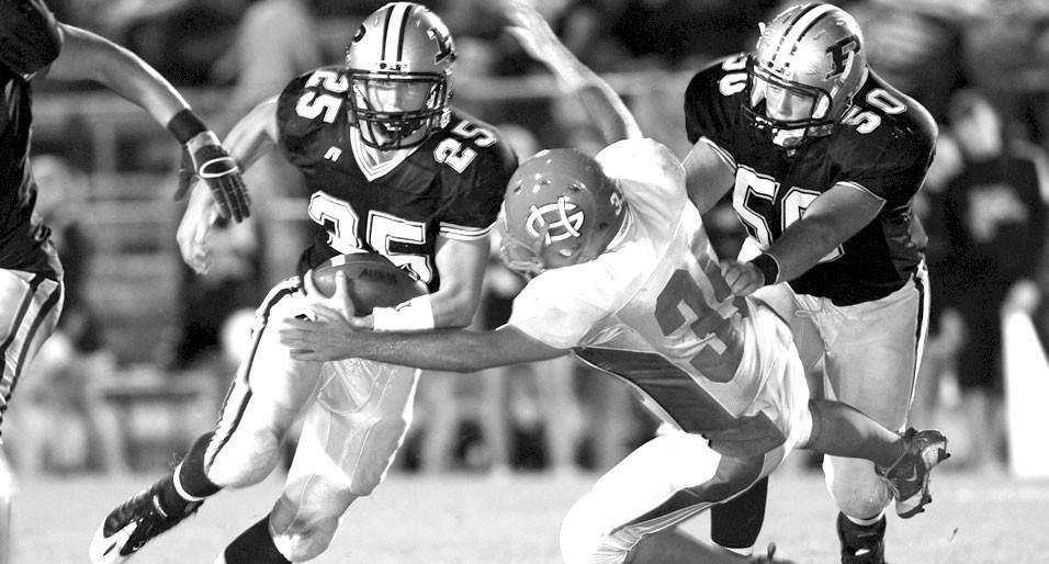 –courtesy www.southernexposurephotos.com Pennington's Brandon Cole (25) picks up yards thanks to a block by Zach Hyatt (50).