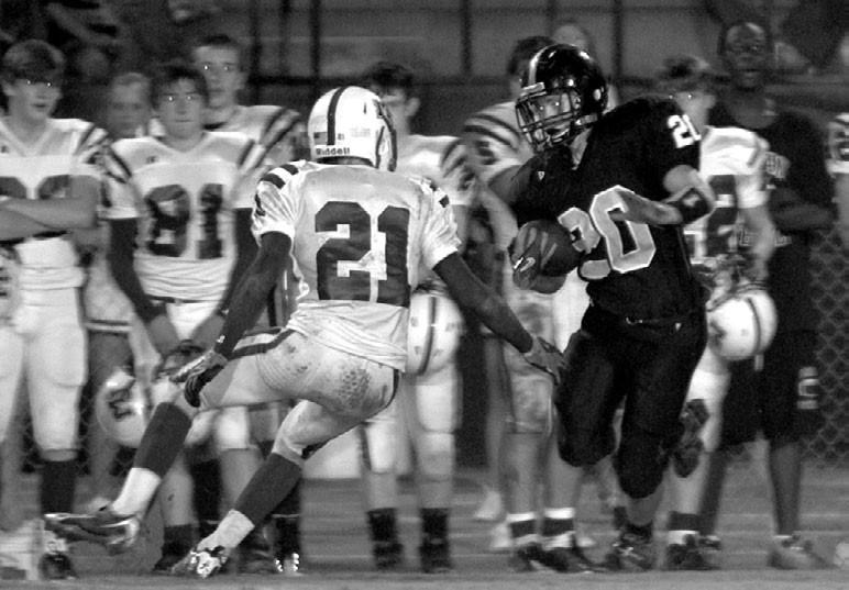 –courtesy www.southernexposurephotos.com Hayden running back Isaac Veitch cuts around a Mortimer Jordan defender.