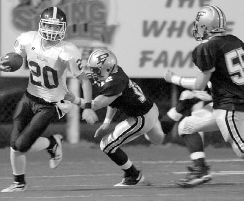 –photo courtesy www.southernexposurephotos.com Susan Moore running back John Evatt (20), shown earlier this year against J.B. Pennington, had 105 total yards in the Bulldogs' 27-21 win over Sardis last week.