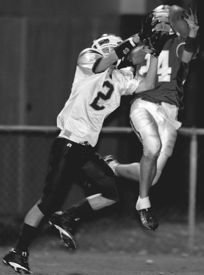 –courtesy southernexposurephotography.com Appalachian's Jacob Chappelle pulls in a pass in front of a Gaylesville defensive back.