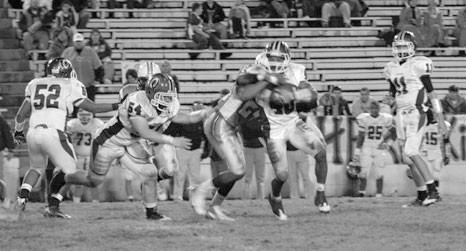 –courtesy J.D. Brooks Oneonta running back Vernarr Hughes tries to get away from a Fayette County tackler.