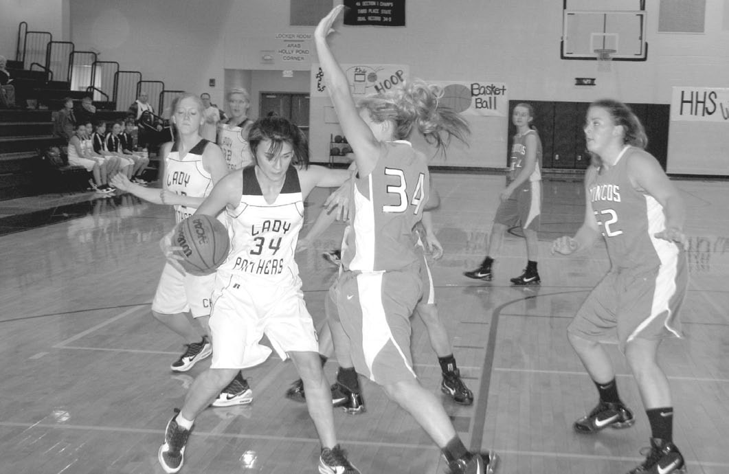Cleveland's Jessi Holder tries to make a little room against Holly Pond in the Hayden Christmas Tournament.