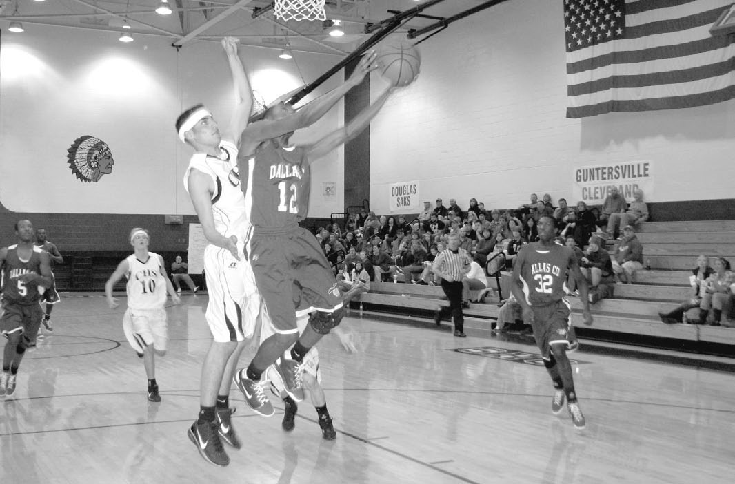 Cleveland's Caleb Woodall refuses to give up an easy layup.