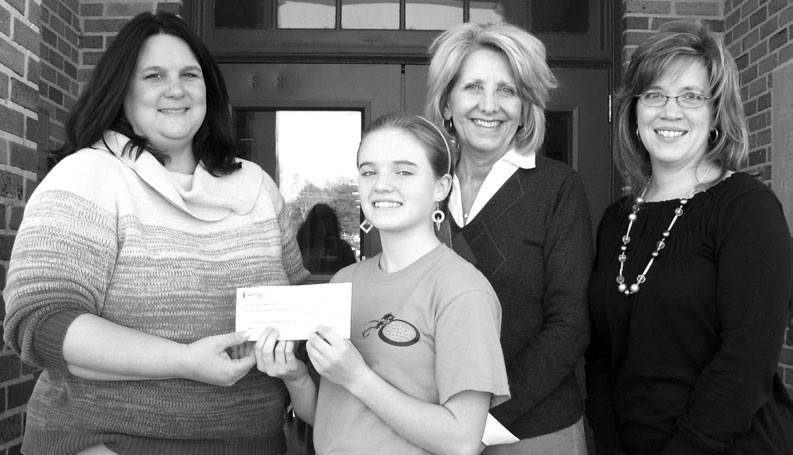 Hayden Middle School student Maegan Dailey (second from left) willingly holds a check for $656.79 which fellow students collected for Haiti Relief. Pictured with her are Christine Arnold (from left), Blount County Red Cross executive director, and educators Becky Lary and Suzette Johnson. Hayden schoolers collected the money as a project for the Red Cross.