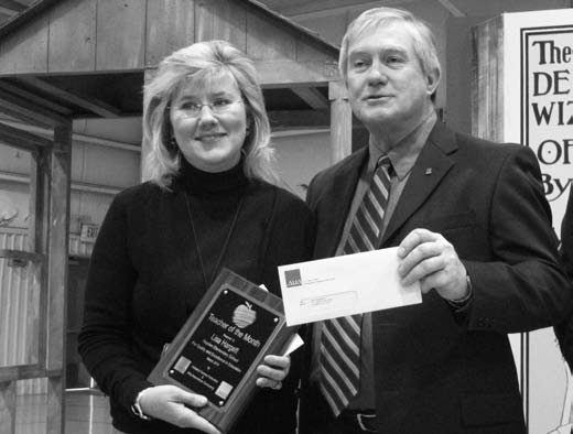Lisa Hargett accepts her award from Jim Wilson, agent with ALFA Insurance Company.