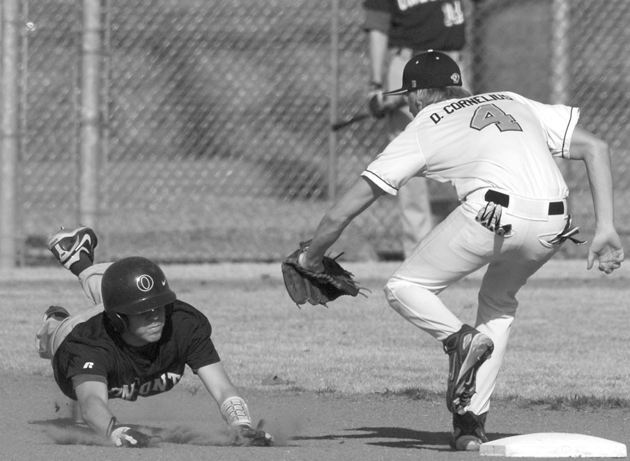 Cleveland short stop Dusty Cornelius tags a Redskin baserunner during last week's Blount County Tournament championship game.