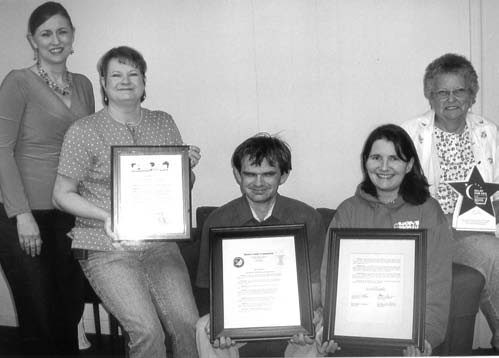 """Blount County Relay for Life Committee members display proclamation from Blount County Commission and City of Oneonta declaring April """"paint the county and city purple"""" month. Shown (from left) are Lisa Haugen, Pennie Bickerstaff, Greg W. Jones, Brenda Trujillo, and Martha McAnnally."""