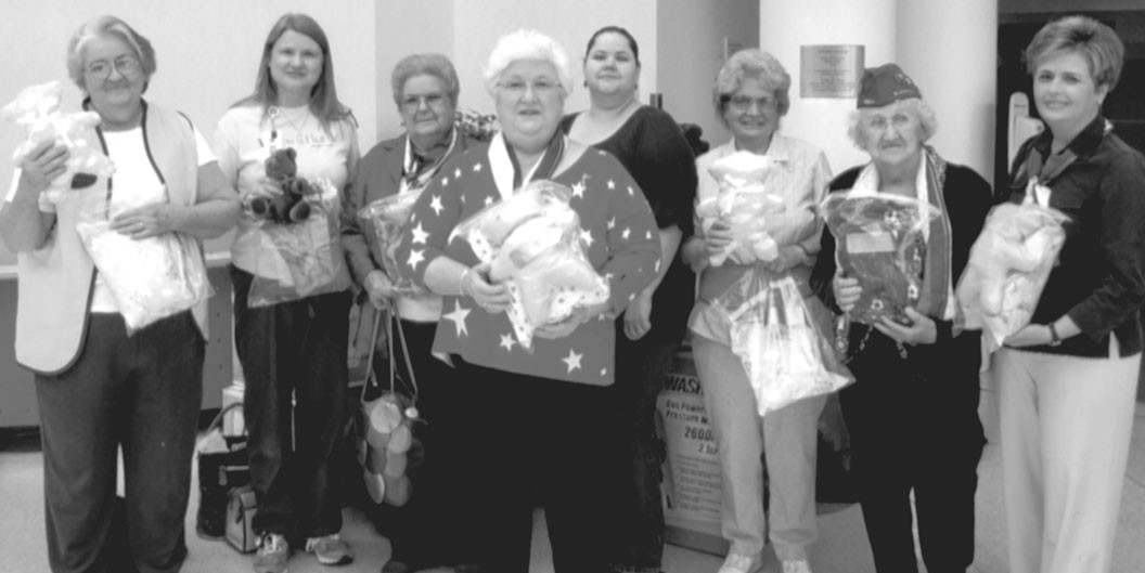 Delivering gifts for patients at Children's Hospital are Snead VFW Auxiliary members: (from left): Sonia Stephens; Kimberly Dickinson, child-life assistance; Betty Smith; Amanda Strange, secretary; Charlotte Latta; Bess Latham; Teresa Lindsay, treasurer; and (center) Beverly Mize, president.