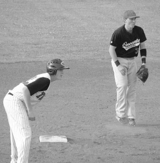 Redskin second baseman Chase Bryant holds a Cleburne County baserunner on.