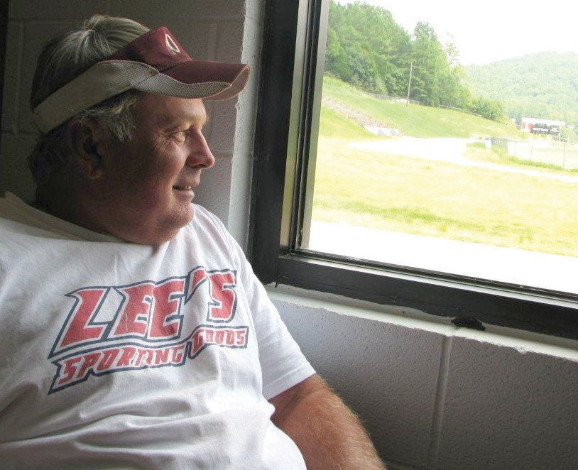 New Redskin head coach Don Jacobs looks out at Gilbreath Stadium.