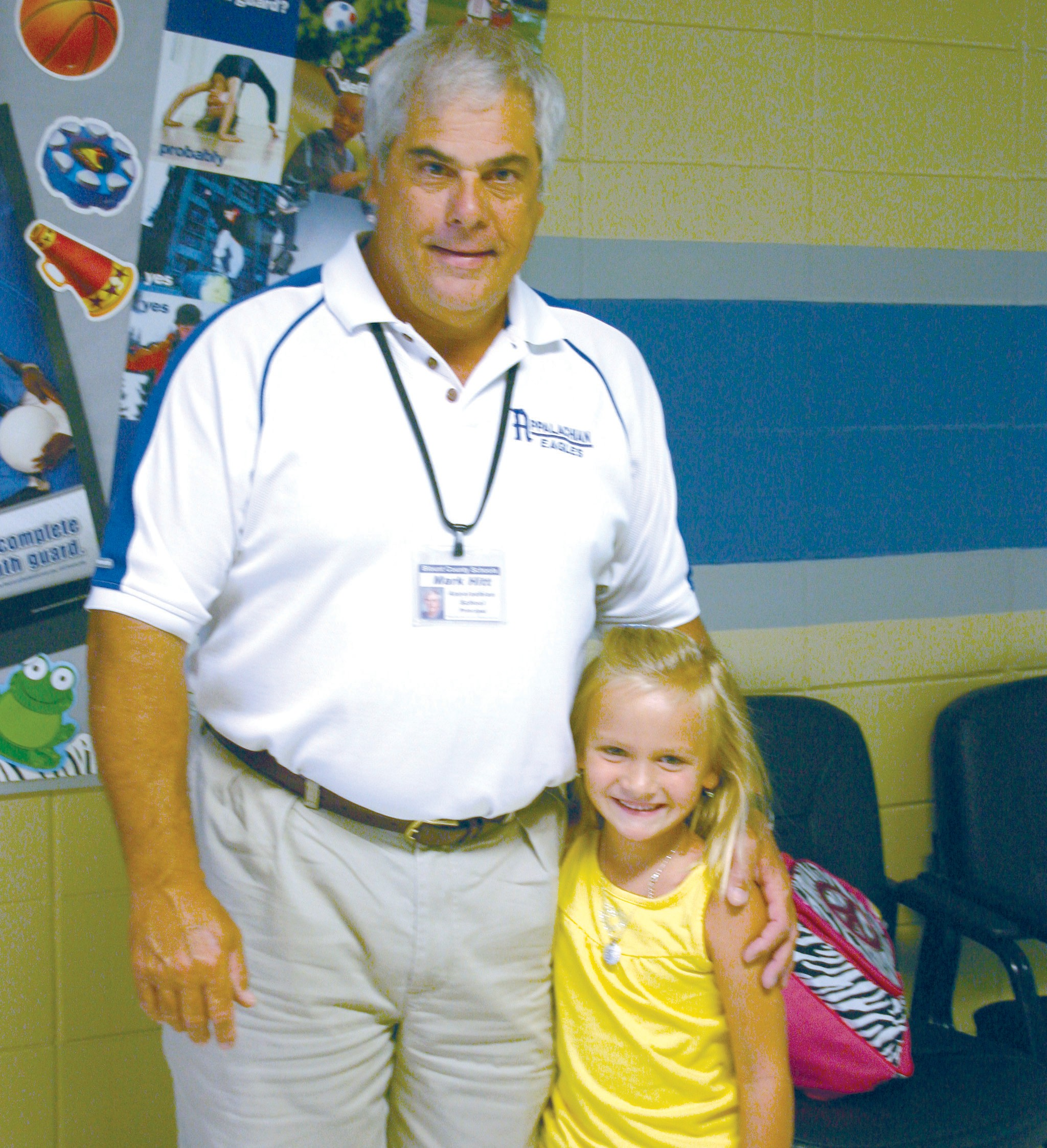 Sophie Latta is greeted on the first day of school last week by Appalachian School principal Mark Hitt. Sophie is one of 46 new kindergarten students that began the year at the school. Thursday was the first day of school for all students in both the Blount County and Oneonta City systems. Sophie is the daughter of Chris and Paige Latta. –Rob Rice