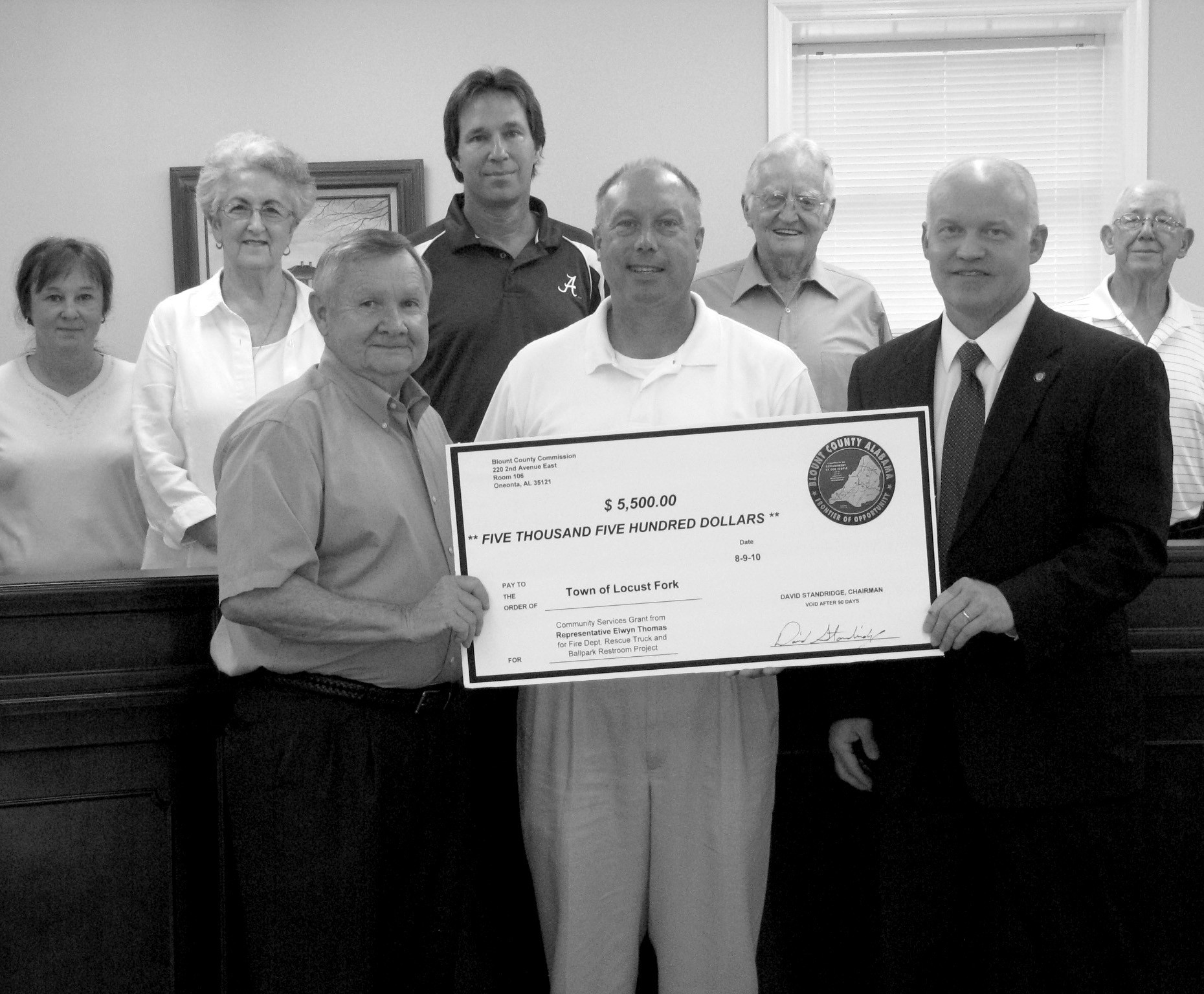 Locust Fork has been awarded two community services grants totaling $5500, presented Aug. 10 by Rep. Elwyn Thomas and County Commission Chairman David Standridge. A grant of $2500 will go toward the remodeling and new construction of the town park's restrooms. The one for $3000 will go to Locust Fork Volunteer Fire and Rescue and is dedicated to the purchase of a new rescue vehicle. Shown above are (back from left) Tammy Riebe, town clerk; councilors Sarah Holt, Greg Sherrer, Charles Gilliland, Robert Chamblee; (front) Thomas, Mayor Joseph B. Hughes, and Standridge. – Tanna Friday