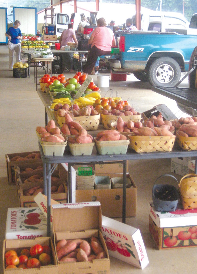 """Early morning farmers market at Agribusiness Center: """"Whatever else happens, that farmers market has got to stay open,"""" said District 3 Commissioner and Agribusiness Board member Tom Ryan."""