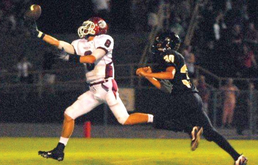 Oneonta receiver Lee Mitchell hauls in a touchdown pass one-handed as Hayden's Nathan Turley closes in. The Redskins held off the Wildcats to win 42-32 and improve to 4-1 on the year while Hayden fell to 2-3. Each team has a tough region game at home this week as Hayden hosts Walker and St. Clair County visits Oneonta. -Rob Rice