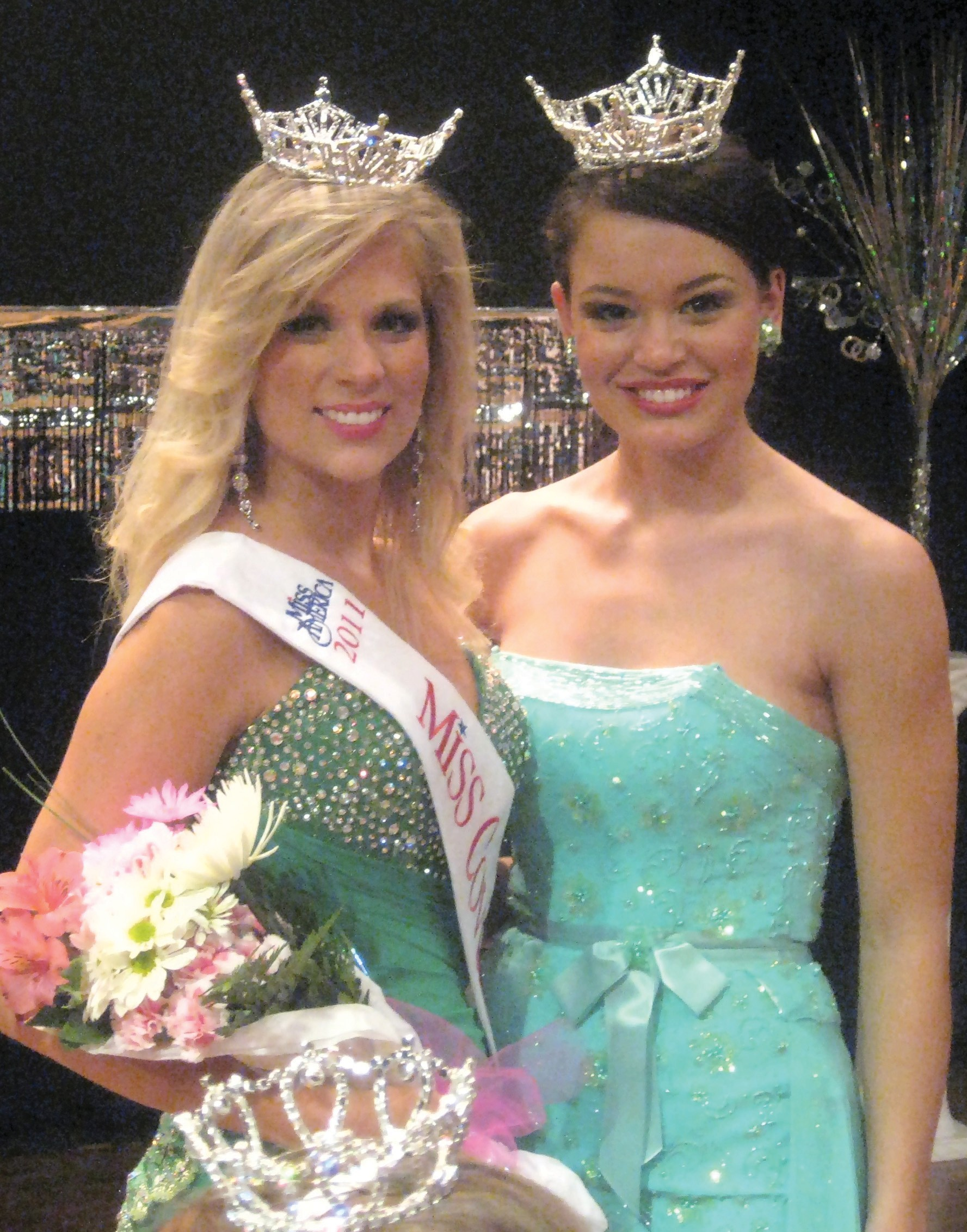 """Meghan Muncher (left), shown with Miss Alabama Ashley Davis, was crowned 2010 Miss Covered Bridge Sunday night, winning the title in a field of 20 contestants. She won the crown with a strong ballet en pointe performance to """"The Medallion Calls"""" and an impressive platform called """"My Arts Kids,"""" a program to provide fine arts education to elementary school students who, because of public school budget cutbacks, don't have access to fine arts programs. The program, incorporating music, dance, visual arts, broadway musicals, and drama, is financed through Muncher's personal fundraising and pursuit of grants from both private sources and public educational agencies. Muncher, 21, of Jasper, is a senior majoring in dance at The University of Alabama. She was Miss Jefferson County of 2009, and will participate in the Miss Alabama Pageant for the fourth time in June of next year. She is the fifth Miss Covered Bridge, since the local pageant's birth as an official Miss Alabama Preliminary. The pageant, directed by Jayne Posey of Oneonta, was recognized as the outstanding preliminary pageant for 2010. Muncher will make her first public appearance as Miss Covered Bridge during Covered Bridge Festival ceremonies in downtown Oneonta Saturday morning. – Ron Gholson"""