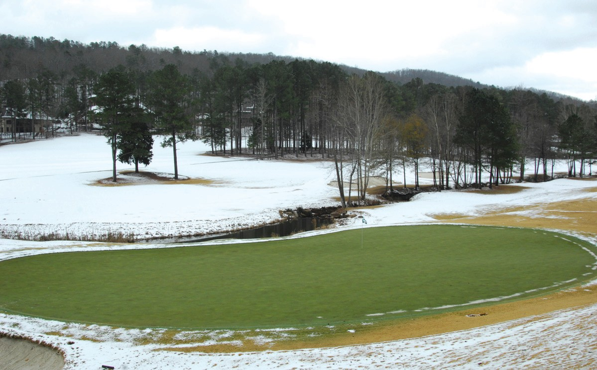 What's green and white and an unexpected gift for all? A green fairway amid fields of white. This is what the 18th hole at Limestone Springs looked like Sunday morning after a few inches of unexpected snow fell on Christmas Day. The contrast of the green, green grass with the sparkling white snow makes a striking – and totally unpredicted – view of the golf course in winter. The photograph was provided courtesy of www.southernexposurephotos.com.