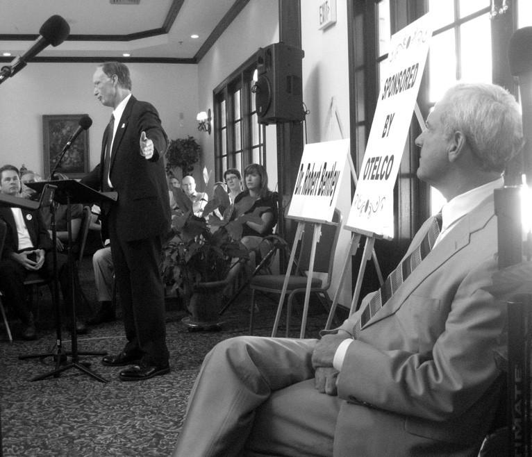 Dr. Robert Bentley (left) begins opening remarks, as Bradley Byrne (foreground) listens.