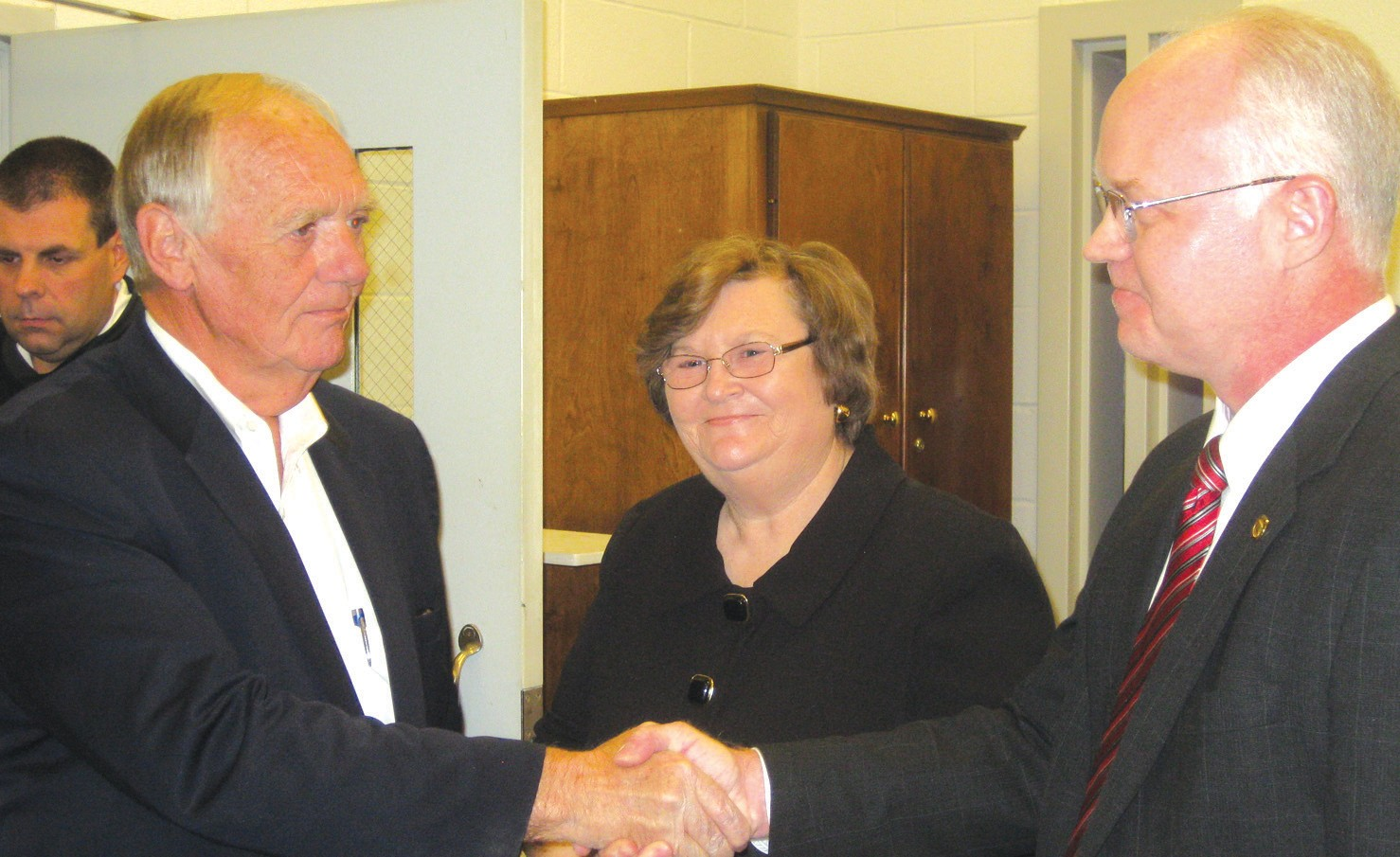 Loyd Arrington (left), is sworn to his first elected term as sheriff of Blount County by Probate Judge David Standridge, as Arrington's wife Norma holds the Bible and beams her approval. Arrington was appointed by the governor two years ago to fill the unexpired term of former Sheriff Danny Morton. He was elected easily in his own right last November. Minutes after this photo was taken, some 30 deputies attending the crowded event were themselves sworn in a mass ceremony.