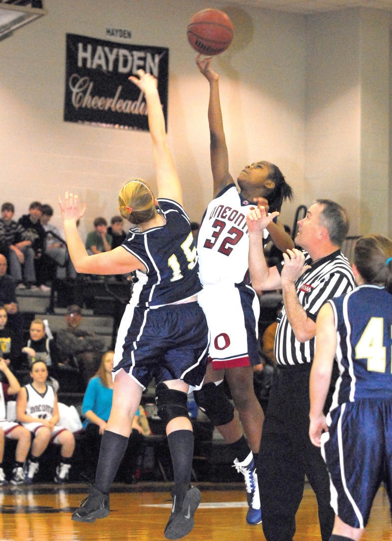 Oneonta's Dynasty Sanders and J.B. Pennington's Lindsey Ratliff battle for the opening tip of the junior high girls championship game at Hayden Saturday night. Oneonta won the girls game 44-20 and then took home the junior boys trophy with a 40-17 victory over Hayden. The varsity county tournament runs this week at Hayden with the first of four championship games set to begin this Saturday at 4 p.m. – Rob Rice