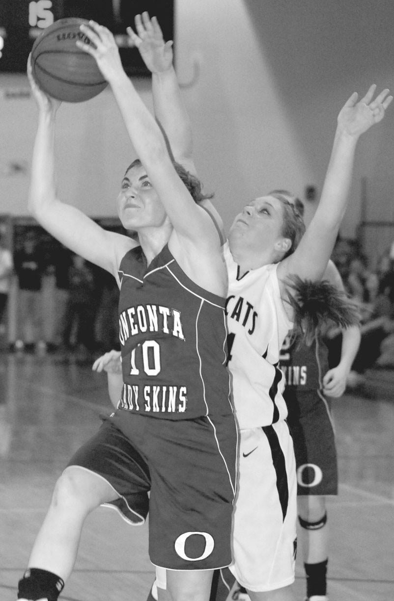 Oneonta forward Charlsie Coefield grabs a rebound in front of Hayden's Anna Shelton.