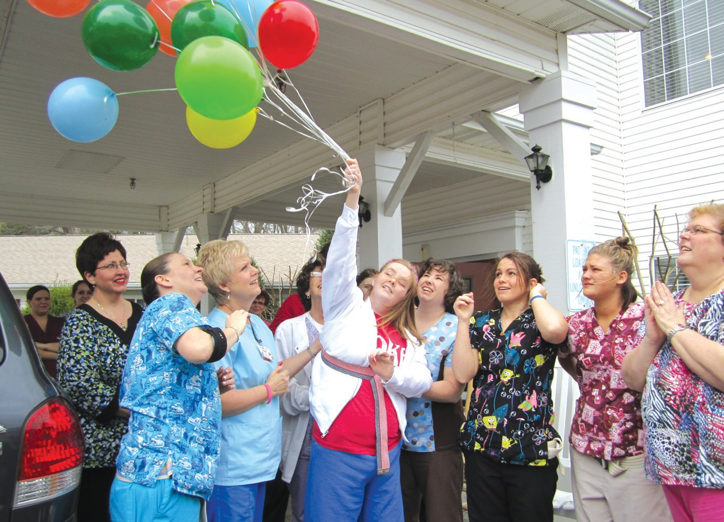 The symbol. Mallory releases balloons in celebration of her own seemingly miraculous release from the total bondage of her malady. She will undergo four weeks of intensive speech, physical, occupational, and music therapy, then return home for the first time since the day she was stricken on Sept. 26.