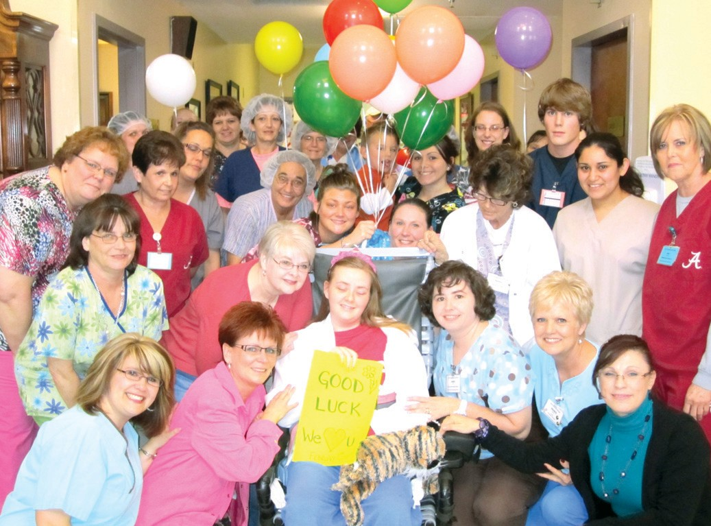 The send-off. Mallory captured the hearts of TLC staffers with a recovery that struck them as both miraculous and heroic. Over 50 of them jammed the hallway and closed ranks behind her as she prepared to depart last week for Lakeshore Rehabilitation to continue her comeback. Moments later, Mallory defied her own initial diagnosis by walking through the doors of TLC, with assistance, and getting into the car for the trip to Birmingham.
