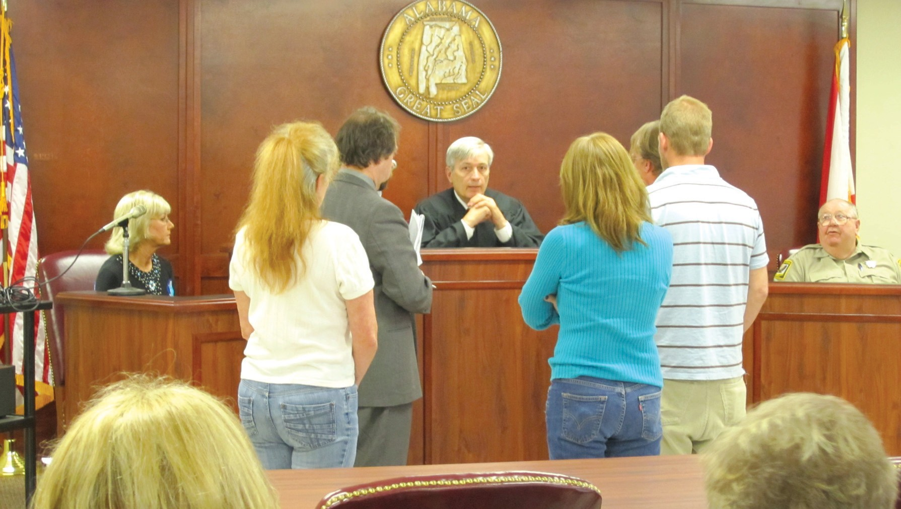 Drug court clients appear weekly before drug court Judge John Dobson to report on the week's results and progress. Sometimes the subject is more serious, like this hearing, attended by family members, on referral to a longterm treatment facility.