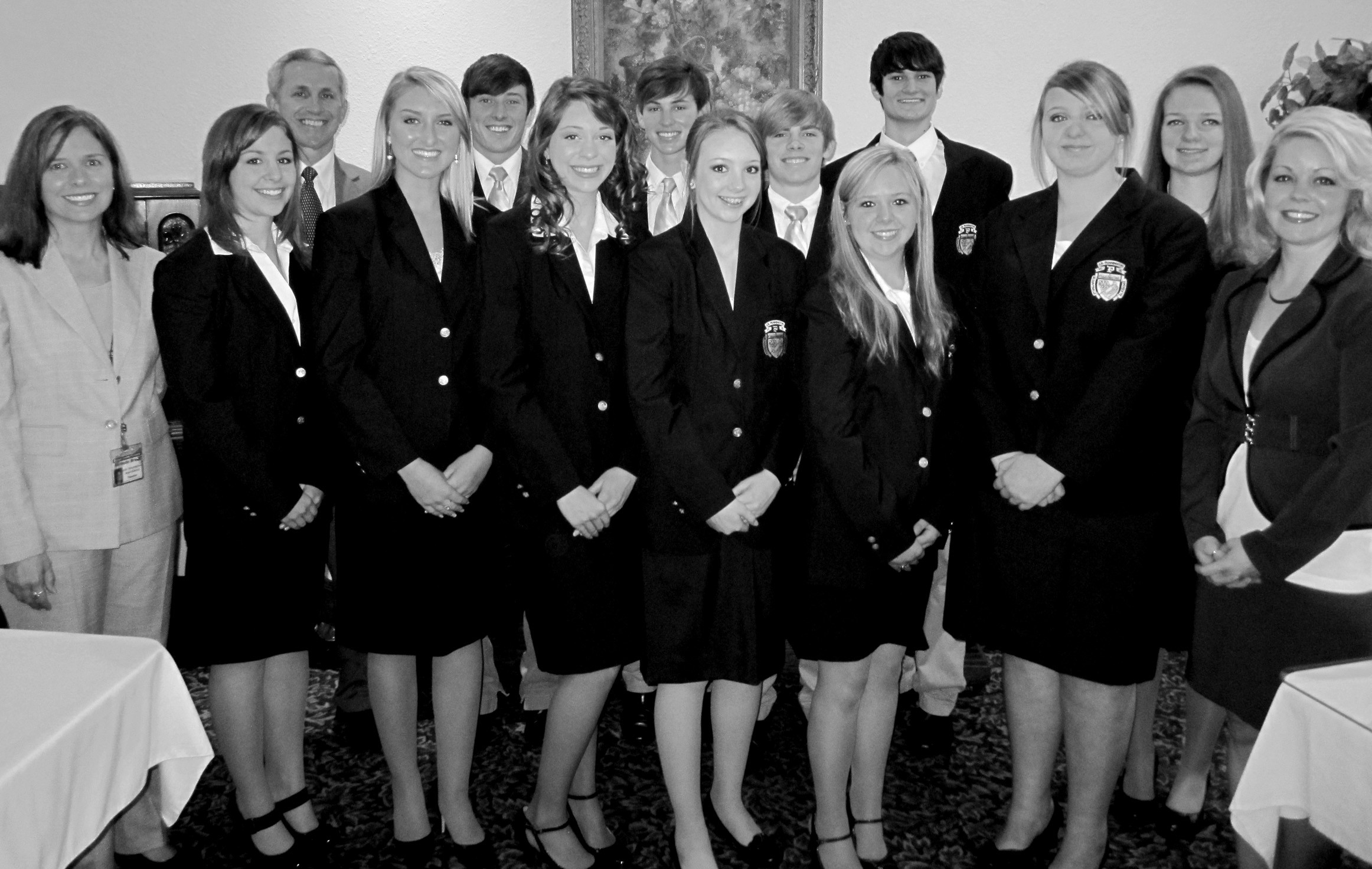 Eleven Pennington students, members of the Blount County Ambassadors program, served as greeters at the chamber of commerce breakfast on March 9 at Twin Oaks. Ambassadors at all county high schools are being introduced at chamber breakfasts this year to highlight the school leadership and citizenship program. Pictured are (front row from left) Michelle Brand (sponsor), Rhiannon Akins, Jessica Neill, Whitney Brown, Amelia Dorning, Christy Hightower, Ashley Bryant, Megan Sypniewski, and Jessica Musso (sponsor); (back row, from right) Hunter Cornelius, Joe Blocker, Andrew Vaughn, Ben Bailey, and chamber of commerce director and ambassador of another sort, Donny Ray. – Ron Gholson
