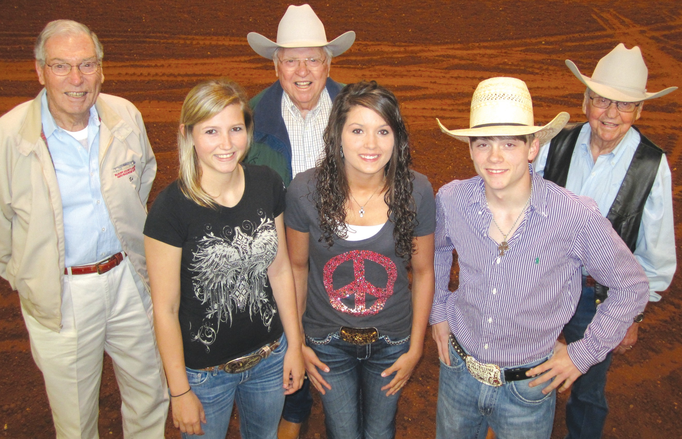 A whole generation's missing in this shot of Blount County rodeo pros who will take the arena this weekend. But never fear: between these seniors and youngsters, they've got the rodeo covered. Among the young'uns (from left) are Valerie Smith of Oneonta and Anna Smith of Blountsville (no relation) who bring both beauty and excitement to the cowgirl barrel races. Josh Moorer of Rosa says he intends to win – and just might – the bull-riding contest. He nearly did last year. All three are professional riders who travel the rodeo circuit. Meanwhile the senior cowboys have set a record of their own: for 30 years – since the Agribusiness Center first opened in 1982 and hosted its first rodeo in its first week – they've brought the rodeo to Blount County and are not shy about hyping it as the best in the state: (from left) Ed Phillips, Vance Morton, and Ralph Morton, all charter members of the Agribusiness Center annual rodeo production. – Ron Gholson