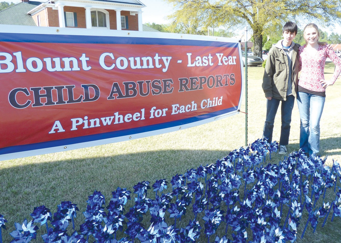 The number of confirmed child abuse cases in Blount County last year was 266. Zach Godwin and Morgan Sargent above know that number because they planted 266 pinwheels in the ground, one for each of those children, as a part of National Child Abuse Prevention Month this April. If you suspect child abuse, don't hesitate, don't agitate, don't investigate. Just call the county Department of Human Resources at 274-5200 and let the professionals take it from there. A child's life could be riding on it. – Ron Gholson