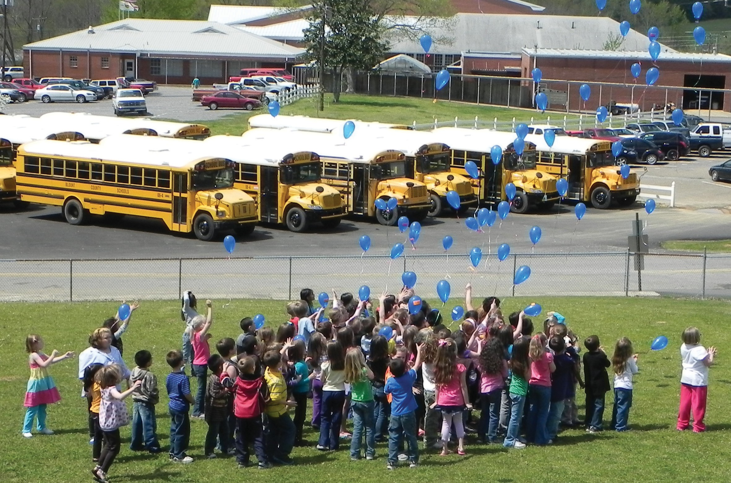 First-grade students release their balloons to Blountsville skies