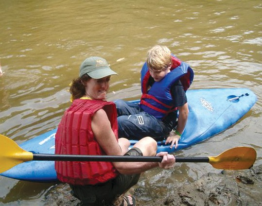 """A young kayaker learns how to keep his boat afloat during a Friends of the Locust Fork River's annual Day on the River. He is one of the many Blount County children in grades 3-6 who have enjoyed past fun days at King's Bend. This June 18 marks the 11th annual event, and young people, their parents, and their families are looking forward to the water sports, nature viewings, critter watching, and other activities that will pack the day, which begins at 8:30 a.m. and ends at 3:15 p.m. Although a lot of the children are fascinated by the snakes and other wildlife they see, some really enjoy the river activities. One youngster wrote the FLFR organization that his """"favorite part was when we got to go kayaking."""" Don't forget to preregister for this year's river party as space is limited. Registration deadline is this Friday, June 10. Everything's free, so don't ignore the deadline and miss out. E-mail dayontheriver@gmail.com, call Susan at 429-3240, or see all the details at www.FLFR.org."""