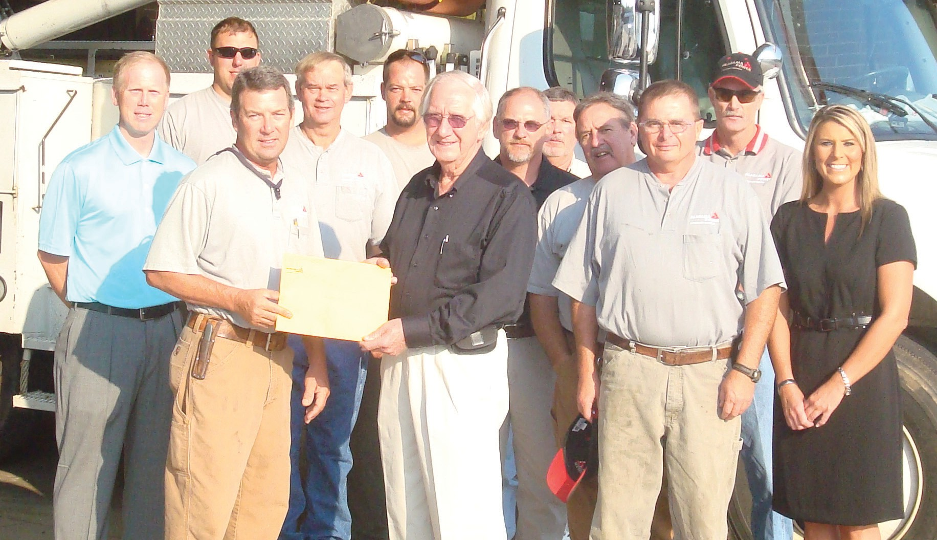 Alabama Power employees show their pride in giving back to tornado victims. Shown above are (front, from left) David Sloan, Bud Jones, and Dale Snead; (middle) Mark Usry, Doyle Blakely, Ricky Hall, Dan Little, and Kelley Cochran; (back) Roy King, Brandon Denney, Bruce Faust, and Troy Cornelius.