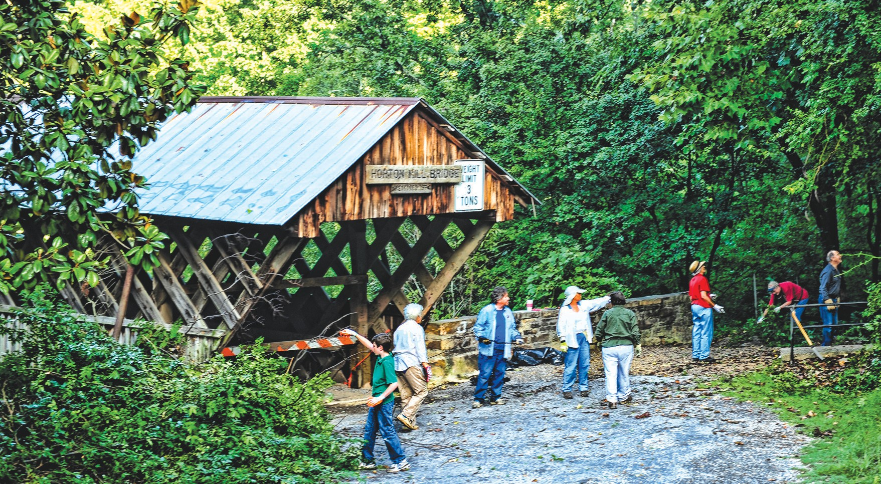 In an effort to keep one of Blount County's signature assets presentable, approximately 20 people showed up last Saturday to clean up around the Horton Mill Bridge. The cleanup project was organized by Friends of the Covered Bridges of Blount County, a group dedicated to preserving and restoring the county's three remaining covered bridges. This group has gained support from local government along with the Blount County Historical Society, Memorial Museum, and the Blount County Master Gardeners Association. For more information about the group, go to www.friendsofthecoveredbridgesofblountcounty.org or call Sharon Murphree at 687-1572. The next cleanup is tentatively set for Swann Bridge with a date and time to be announced later. –Rob Rice