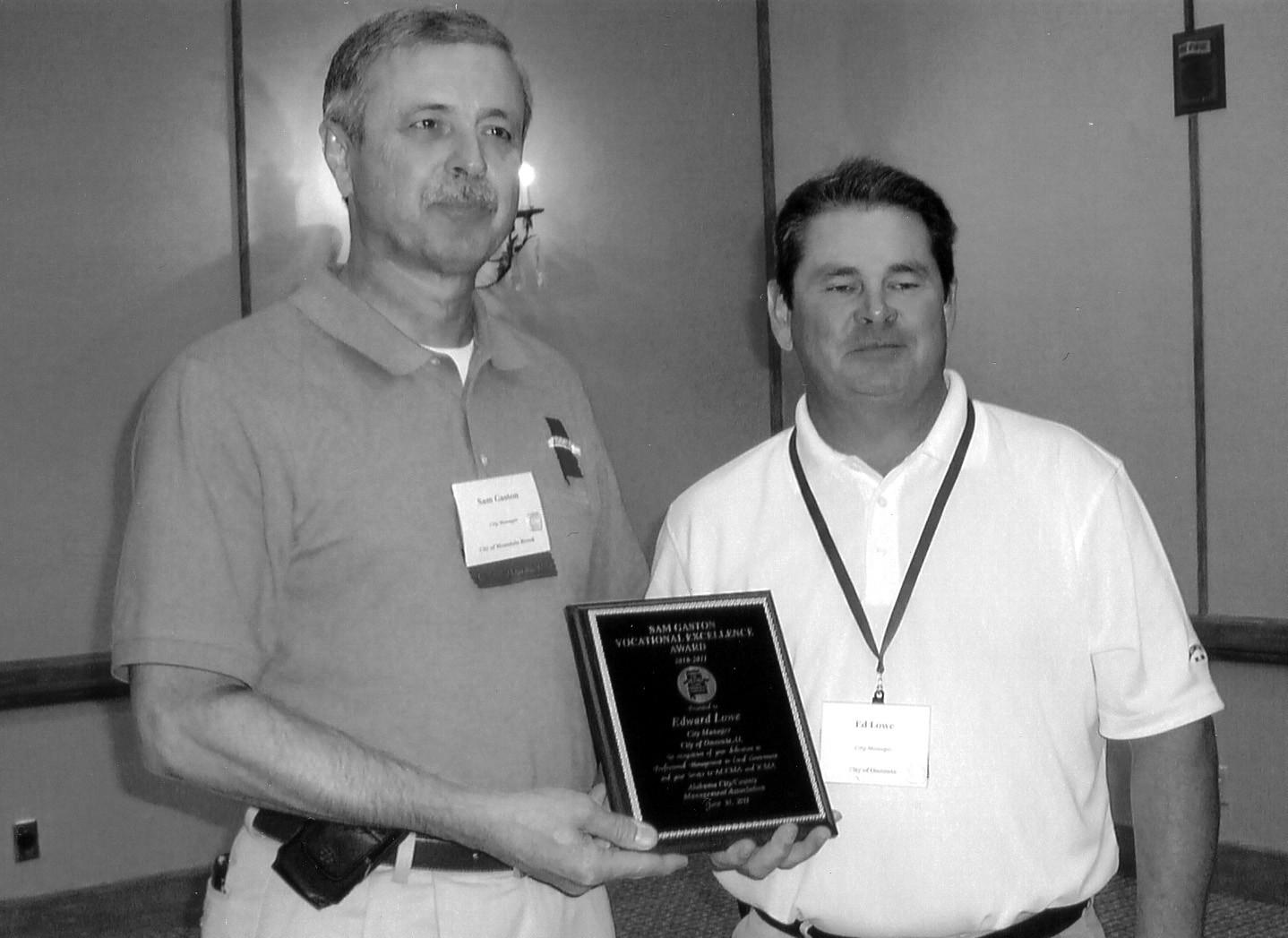 Sam Gaston (left) presents award to Ed Lowe.