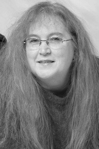 The bookworm is Terri Schlichenmeyer. Terri has been reading since she was 3, and she never goes anywhere without a book. She lives on a hill in Wisconsin with two dogs and more than 11,000 books.