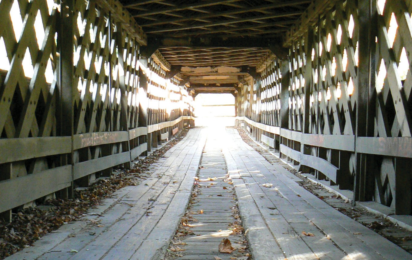 Light at the end of the tunnel? Horton Mill Covered Bridge, shown here, has been closed for repair – along with the county's other two historic bridges – Swann and Easley – since the summer of 2009. They were closed because of their failure to meet load tests conducted by the county.