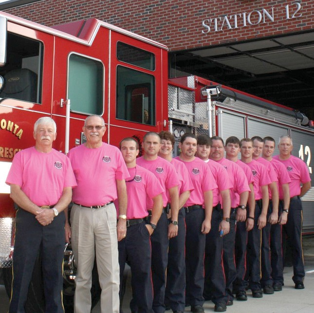 Members of Oneonta Fire Department have a new look: they're wearing pink in support of those who battle breast cancer and in support of breast cancer research. The specially designed shirts are available for order through October at the city hall Monday through Friday, 8 a.m. to 4 p.m. Most of the proceeds will go to the Breast Cancer Research Foundation of Alabama. Pictured above (from left) are fire chief David Osborne, Mayor Darryl Ray, firefighter Dalton Teal, Leslie Loggins, Patreece Mulkey, Quentin Williams, Kyle Dodd, Mike Moore, Josh Gibson, assistant chief Brandon Horton, Joe Pate, Andrew Gargus, Scott Payne. – Ron Gholson