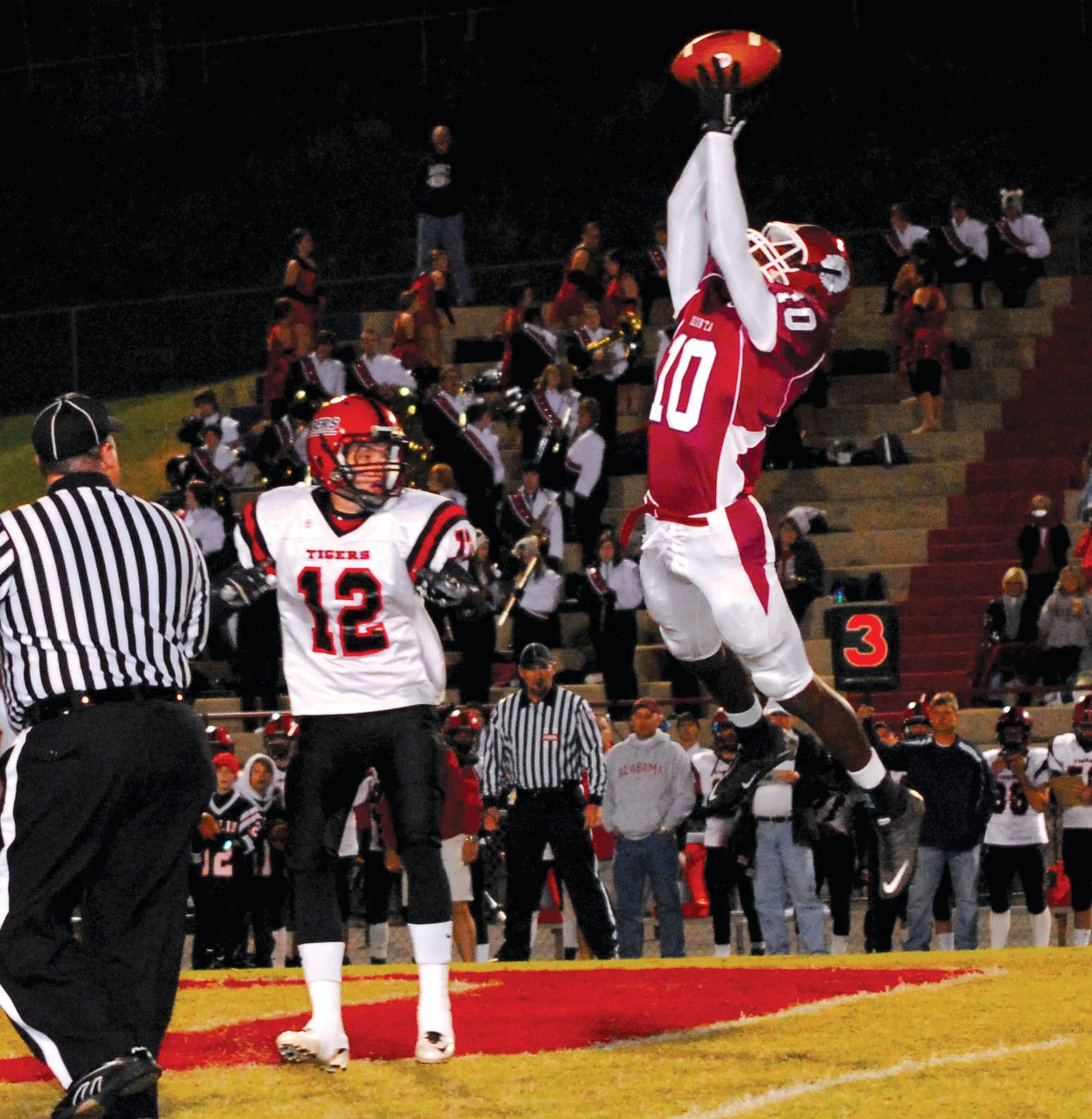 Redskin defensive back Alvin Scott goes high to grab an interception early in Oneonta's 49-34 victory over Cleburne County last Friday night at Gilbreath Stadium. The Redskins are one of only two schools in the county guaranteed a playoff spot – Appalachian is the other. Hayden has a chance to make the playoffs but the Wildcats will need to win this week at Locust Fork to have a chance. See Sports, pg A4.