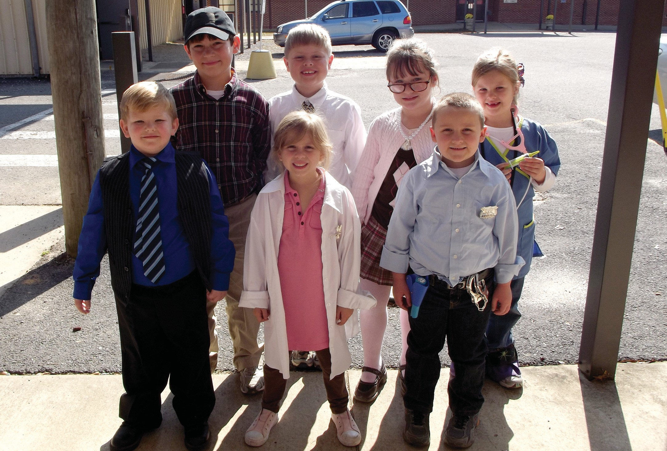 A bunch of heroes: (front row from left) Brandon Lee dresses as a principal; Allyne Darden as a dentist; Owen Thrasher, a police officer; (back row) Kyle Willis, a county road inspector; Owen Darden, a preacher; Allison Willis, a librarian, and McKinley Beavers, a veterinarian.